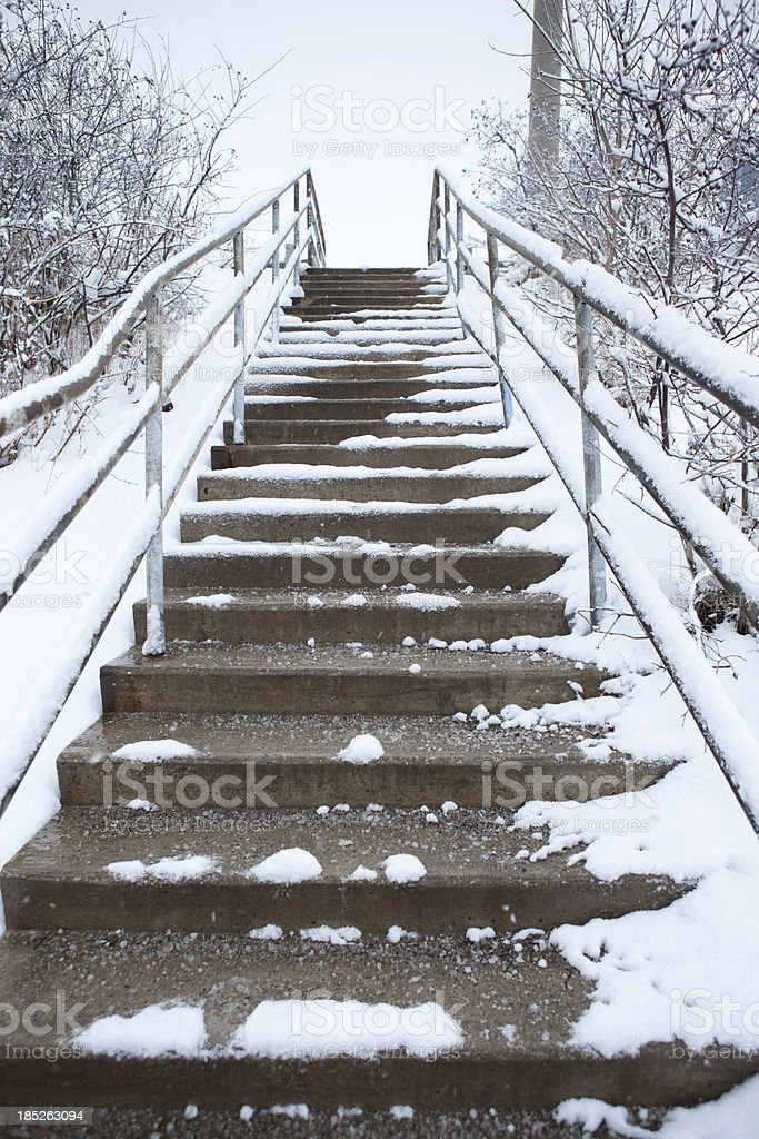 Snow on concrete city steps royalty-free stock photo