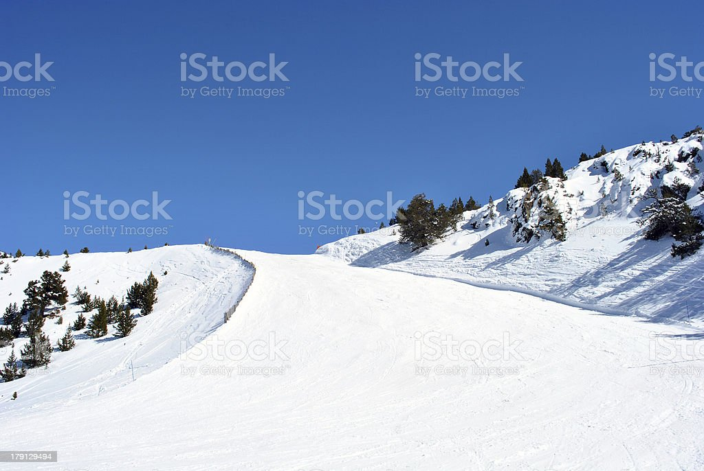 Snow on empty ski and snowboard track route piste stock photo