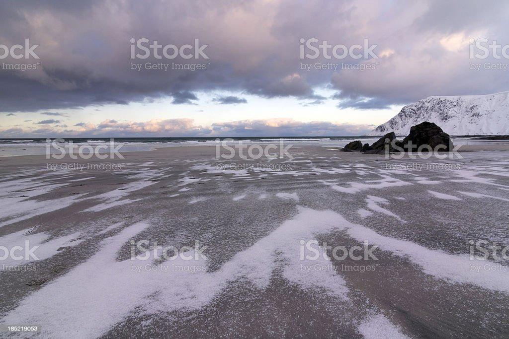 Snow on Flakstad Beach royalty-free stock photo