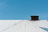 Snow on metal roof texture. Architectural background.
