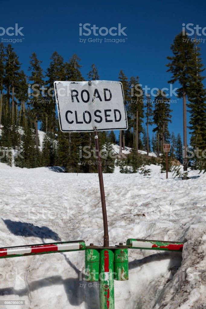 Snow on Mt Shasta Road in late May stock photo