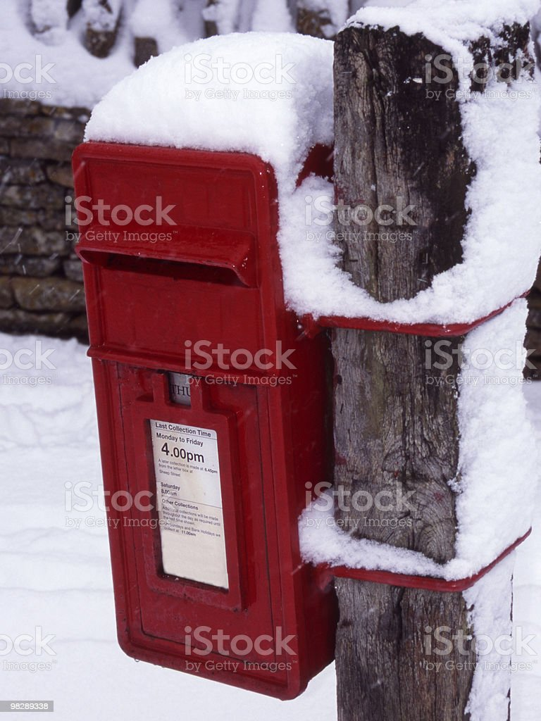 Snow on Red Postbox royalty-free stock photo
