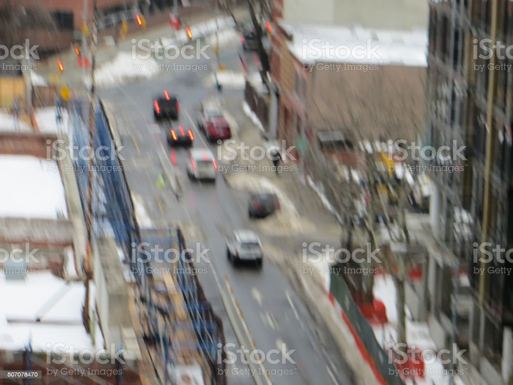 Snow on roof construction site amid scffolding and traffic, Kent-Ave-Brooklyn stock photo
