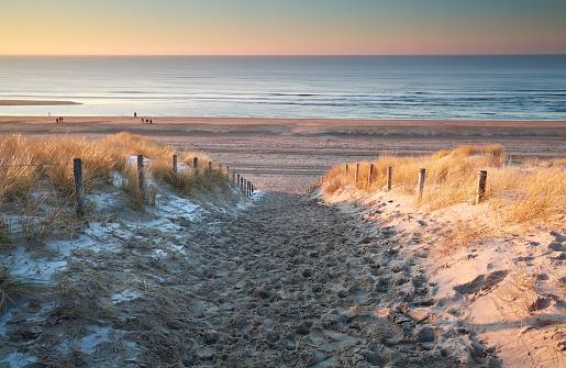 snow on sand dune at North sea coast