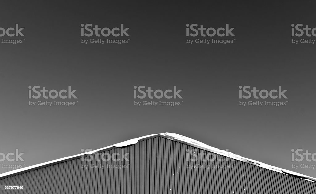 Snow on the roof of metal warehouse. stock photo