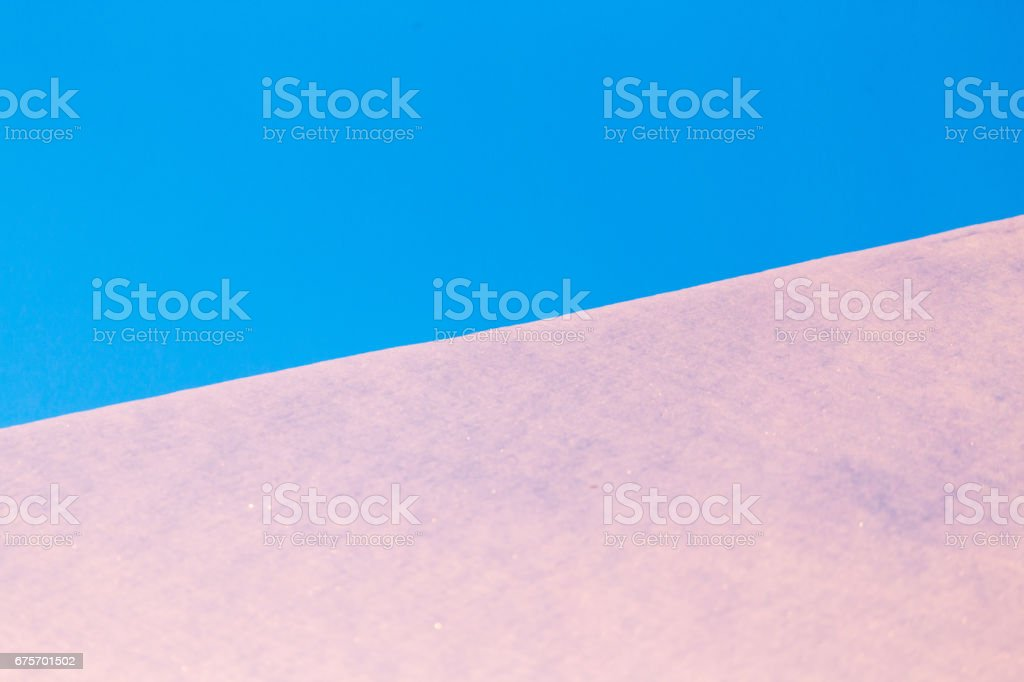 Snow on the roof of the house at sunset royalty-free stock photo