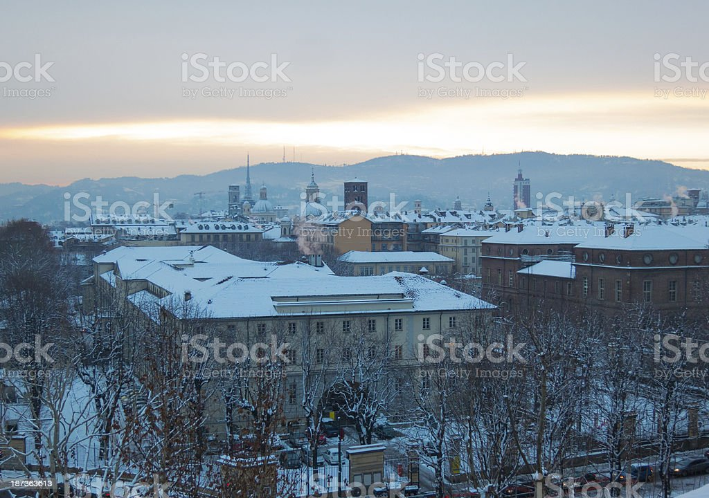 Snow on the roofs of Turin, at dawn stock photo