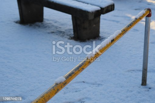 Snow on the safety fence in the park