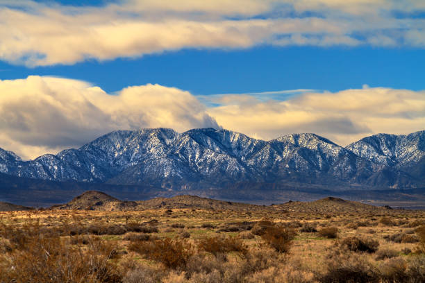 Snow on the San Gabriel Moauntains viewed from the Mojave Desert in California Snow on the San Gabriel Moauntains viewed from the Mojave Desert in California san bernardino california stock pictures, royalty-free photos & images
