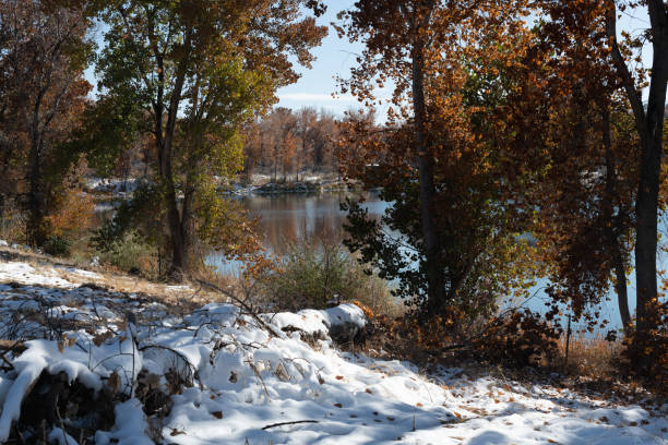 Snow on the shore  of a Colorado lake stock photo