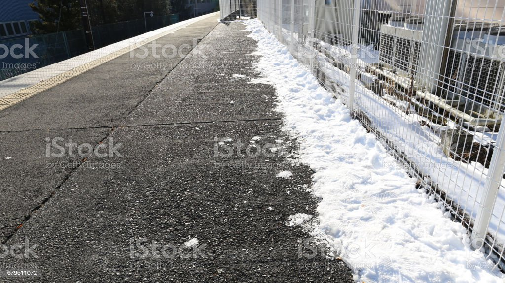 snow on the train platform was swiped to the gate royalty-free stock photo