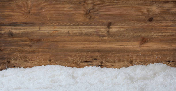 Snow on wooden background stock photo