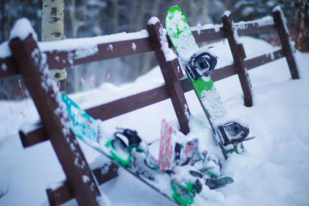 Snow over the ski equipments. stock photo