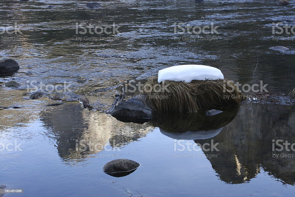 Snow Patch on a Grassy Rock in the Merced River stock photo