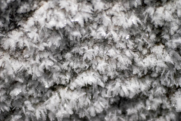 snow pattern cave stalactites weather condensate stock photo