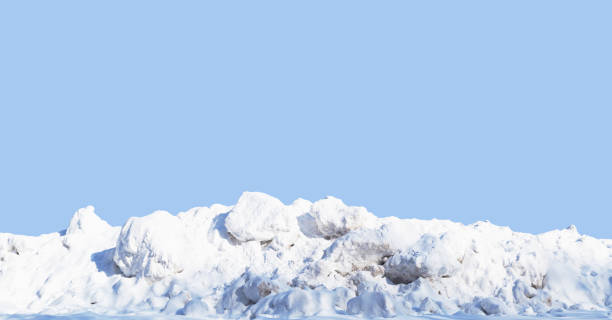 snow pile, hill. large snow drift isolated on a blue sky background, close-up. panoramic view. winter in the mountains. hummock, avalanche - snow pile stock photos and pictures