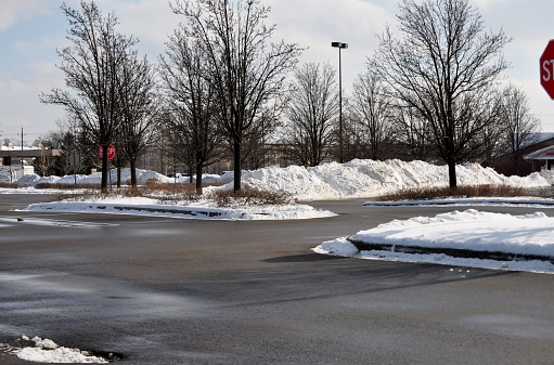 Snow pile on parking lot.