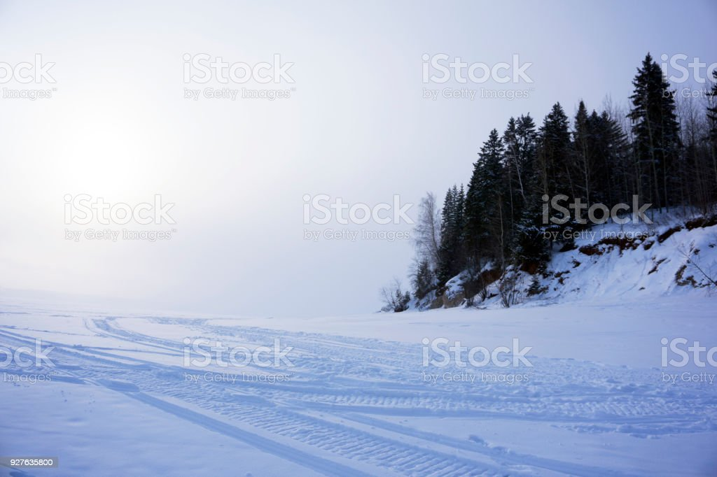 Snow Plain With Snowmobile Tracks Stock Photo - Download Image Now