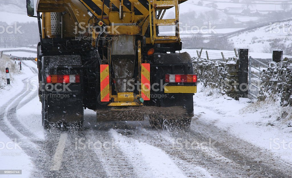 Snow Plough Gritting Roads. Gritting truck. stock photo