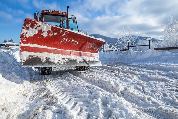 snow plough machine on mountaon road - rudermaschine stock-fotos und bilder