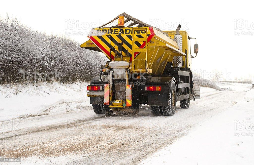 snow plough spreading salt stock photo