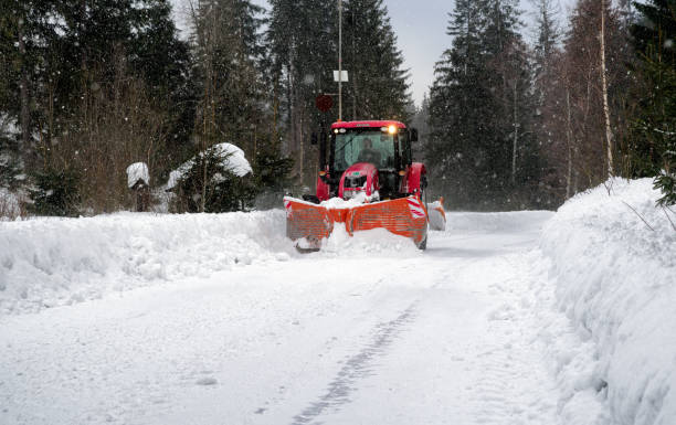 Snow plough vehicle on road stock photo