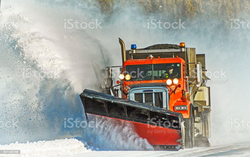 Snow Plow At Work stock photo
