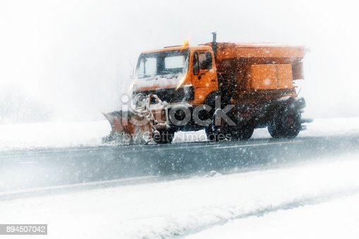 536171925 istock photo Snow plow clearing a snowy highway 894507042