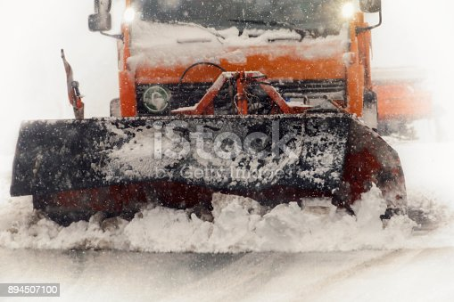 536171925 istock photo Snow plow clearing a snowy highway 894507100