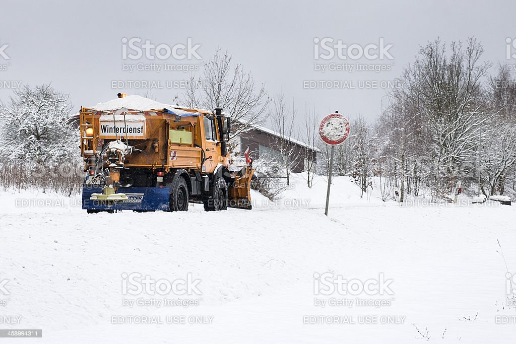 Snow plow in action - winter road conditions royalty-free stock photo