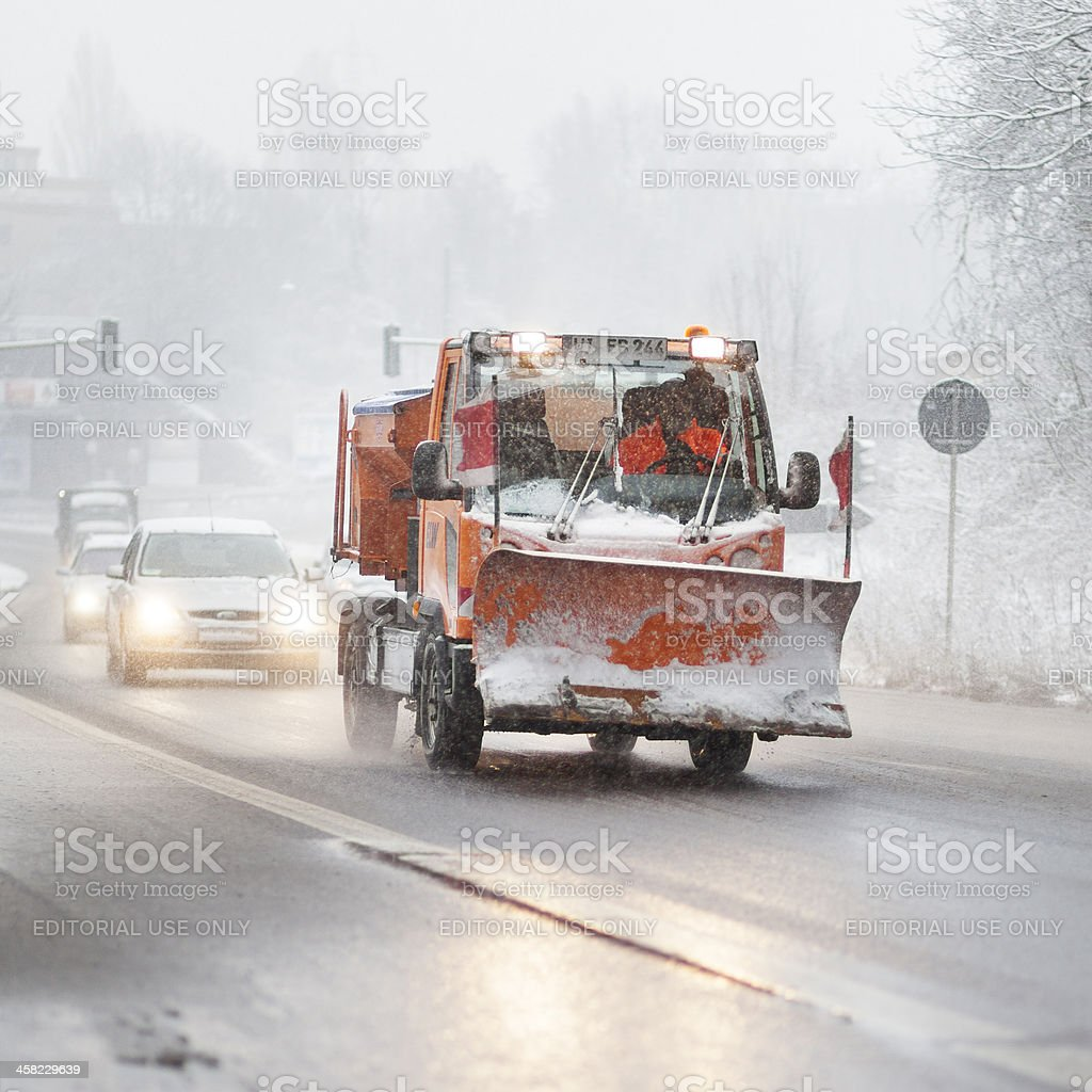 Snow plow mini truck - bad road conditions royalty-free stock photo