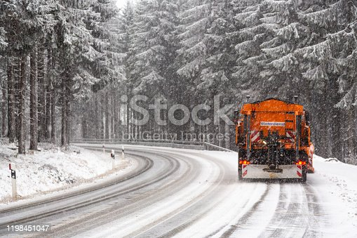 snow plow on forest road