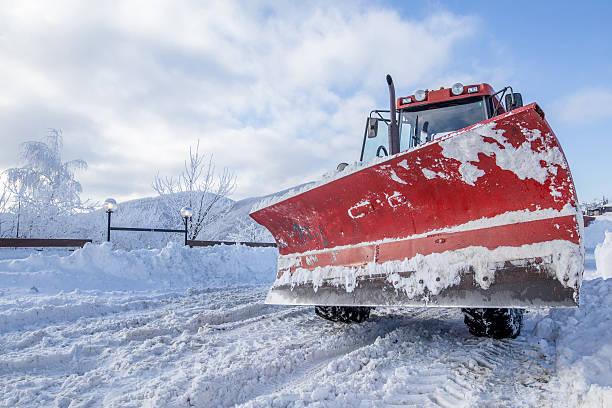 Snow plow on snowy road stock photo