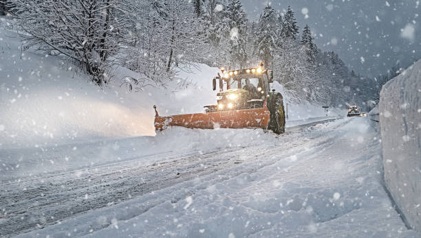 Snow Plow on the Street Full of Snow stock photo