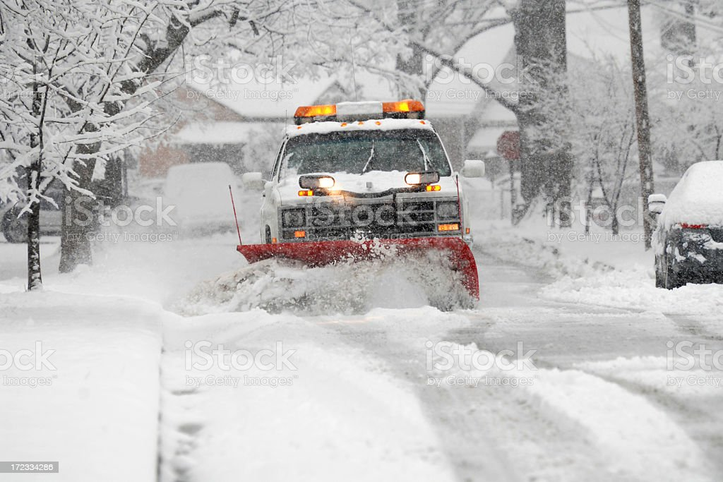 A snow plow plowing the snow in the street royalty-free stock photo