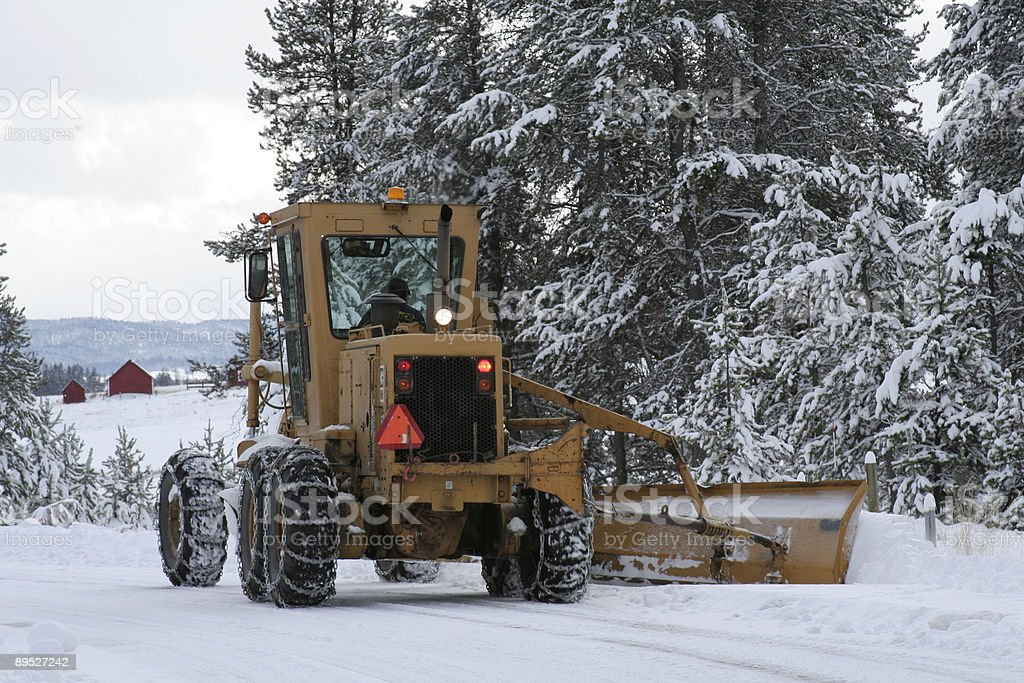 Snow Plow with Barns royalty-free stock photo