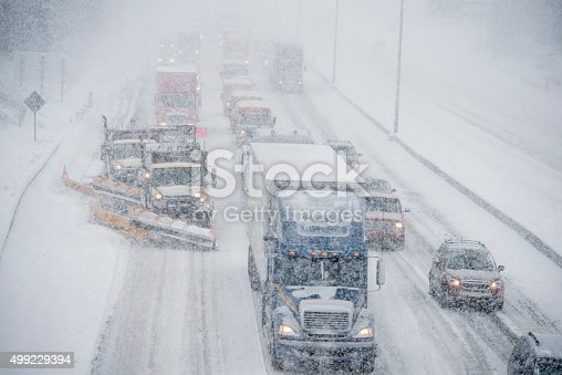 1127834626 istock photo Snow Plows Clearing the Freeway 499229394