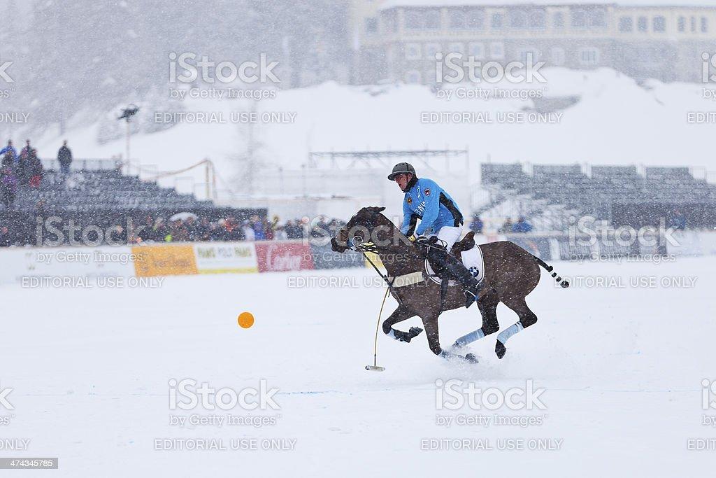 Snow Polo Player Galloping stock photo