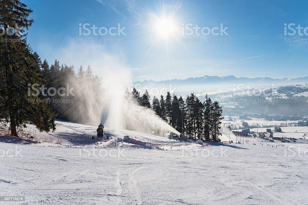 Snow production on a ski slope stock photo