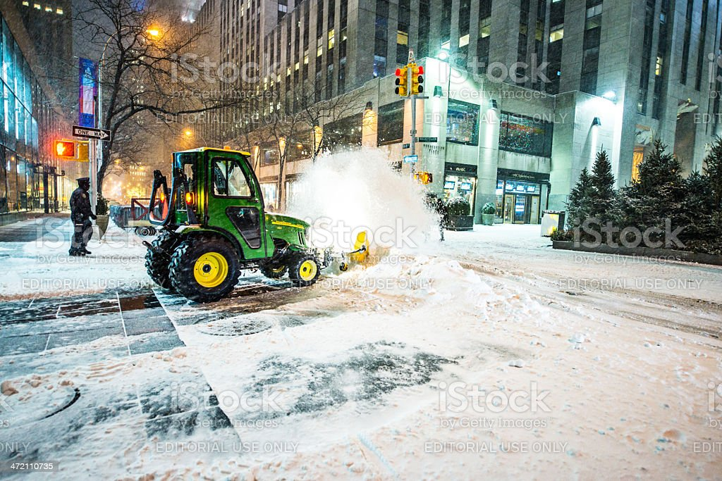 Snow removal on New York street during snowfall stock photo