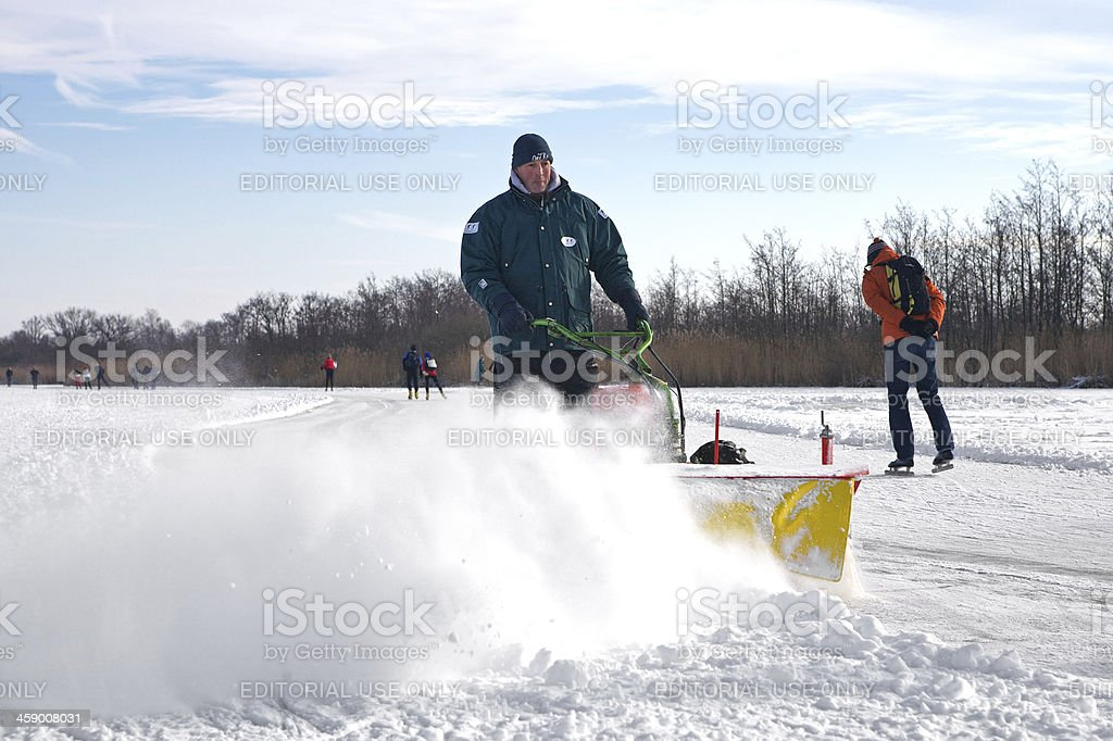 Snow removal on skating lane royalty-free stock photo