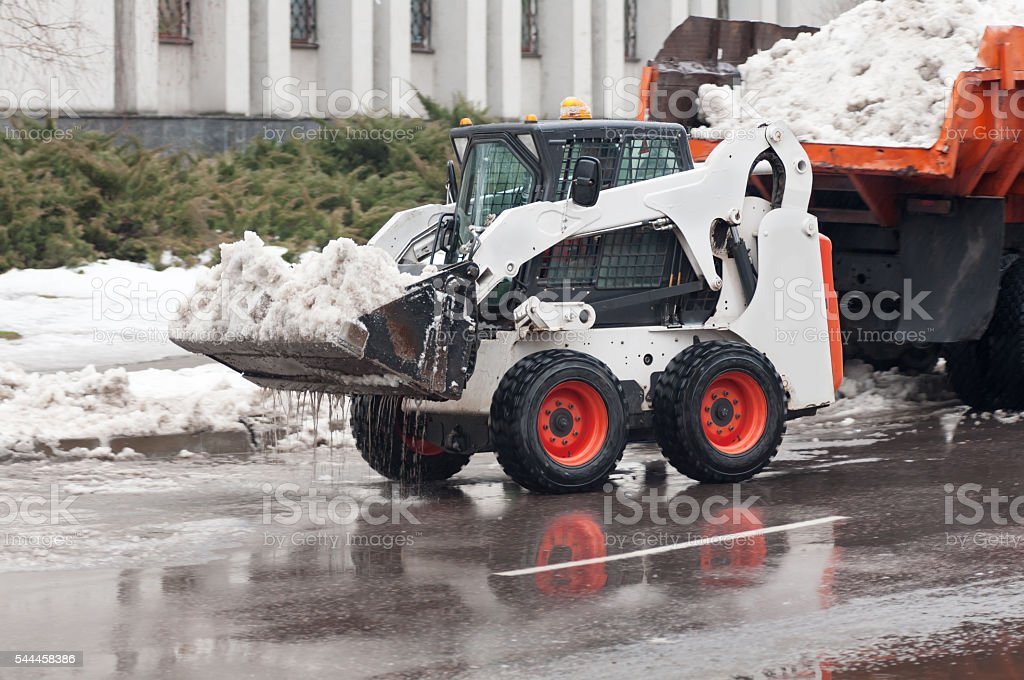 snow removal on the street stock photo