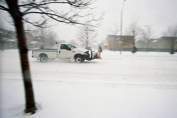 Snow Removal Snow Removal truck in action in a snowy Vaughan morning grifare stock pictures, royalty-free photos & images