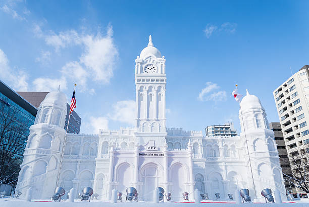 snow sculpture of sultan abdul samad building - sapporo stock photos and pictures