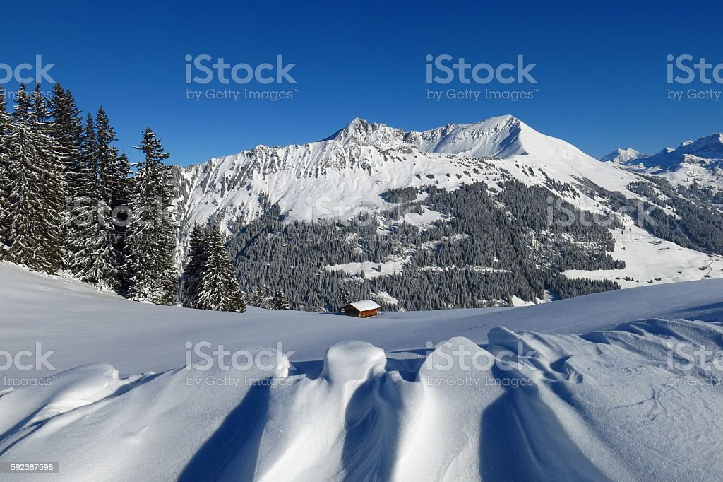Snow shaped by wind and Mt Lauenenhorn stock photo