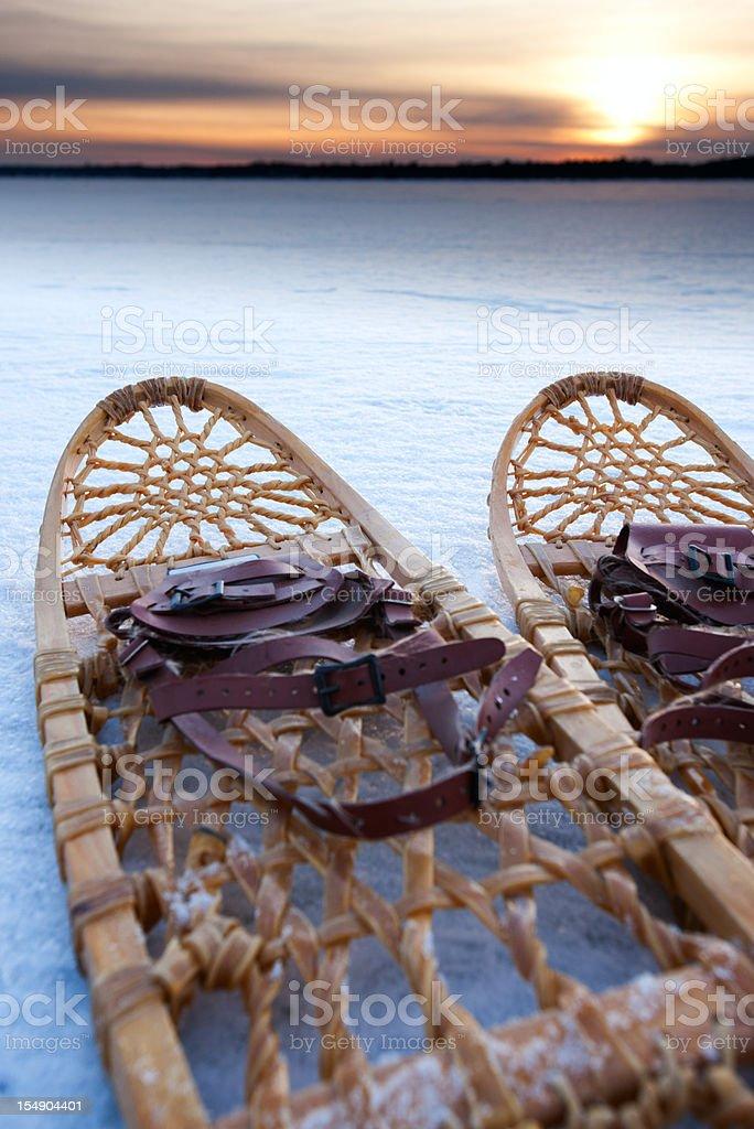 Snow shoes lie on a frozen landscape. royalty-free stock photo