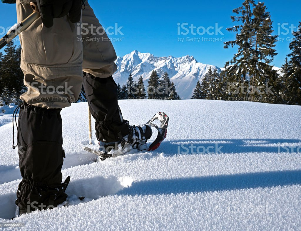Snow shoes with alpine panorama stock photo