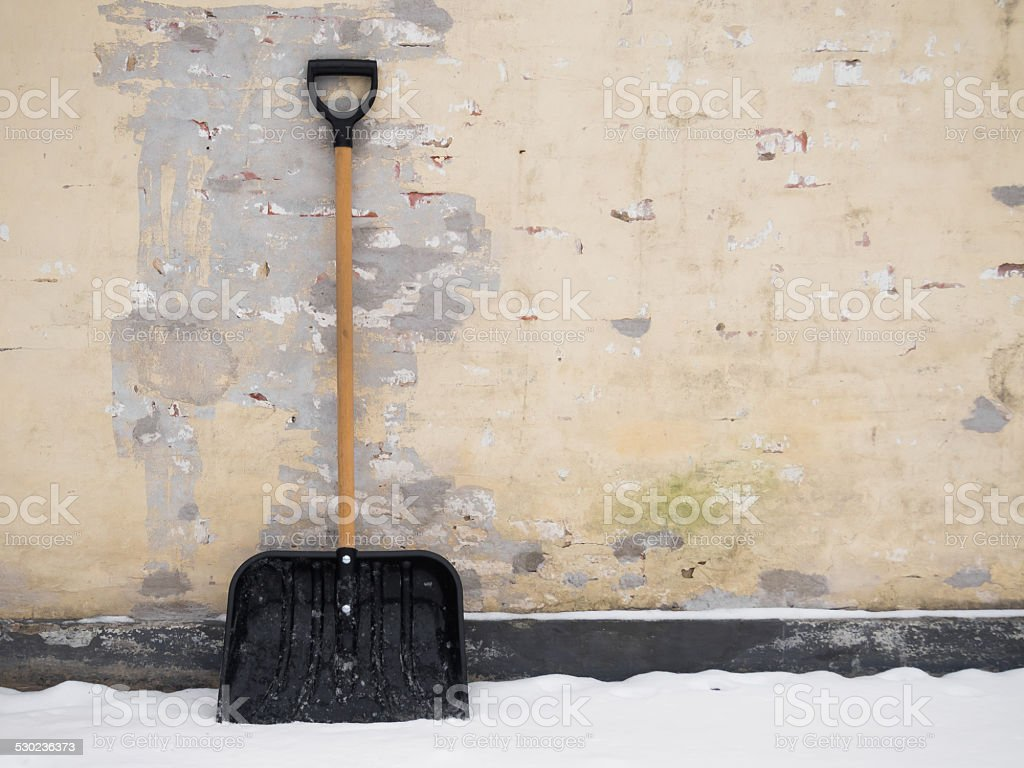Snow shovel out in the snow stock photo