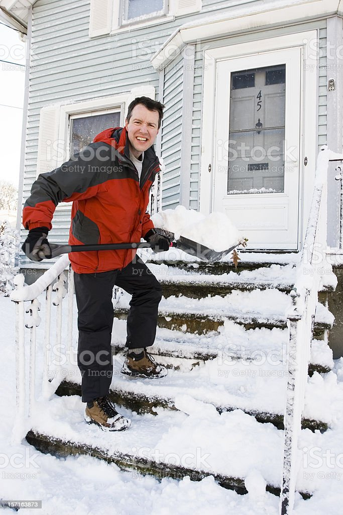 Snow shoveler stock photo
