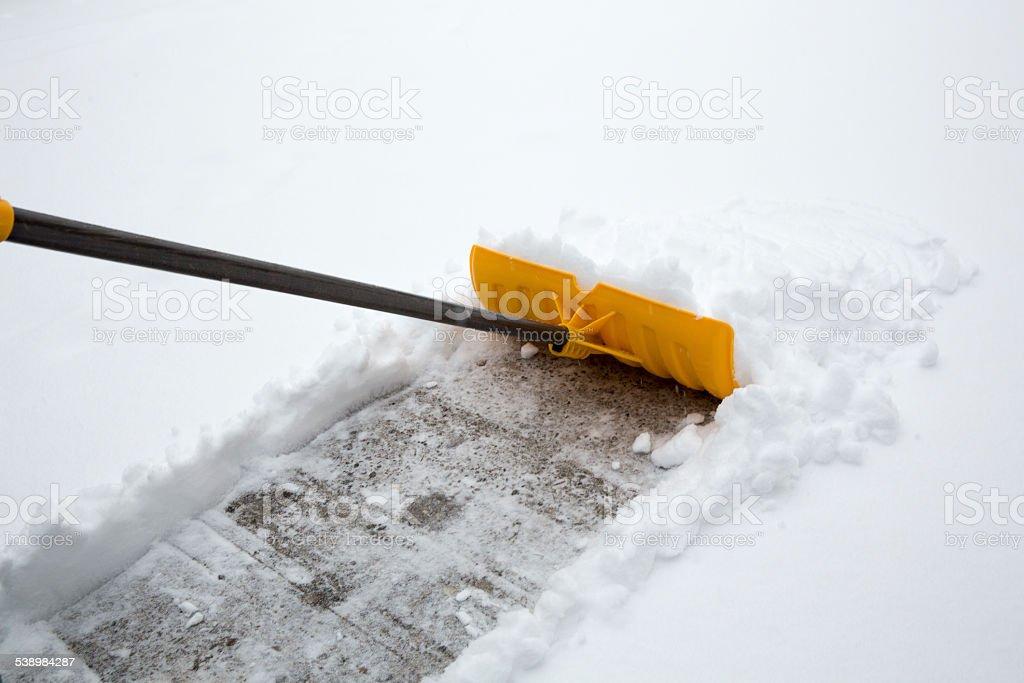 snow shovelling stock photo